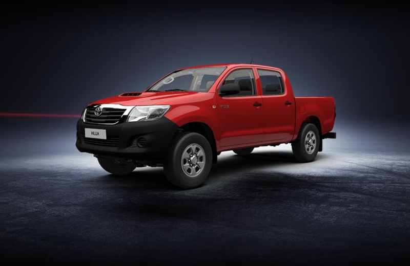 Пикап Toyota Hilux красного цвета